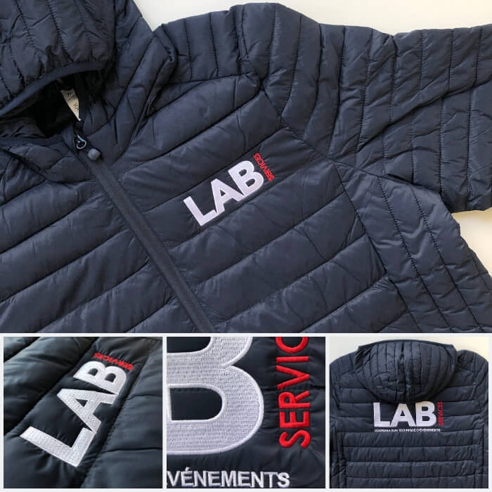 Doudoune brodée de couleur navy avec avec logo de l'entreprise LAB services