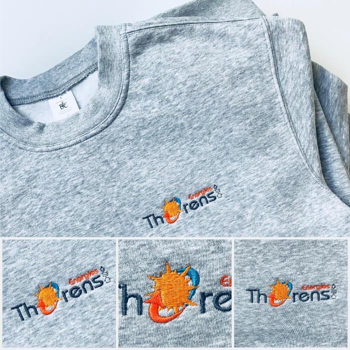 Sweats personnalisés gris chiné avec le logo Thorens Energies de brodé sur le coeur.